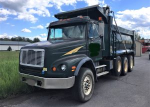 2000 Freightliner tri-axle dump truck with 434'975 miles. Has a Caterpillar C 112 diesel engine with 445 horse power and 2 stage Jake. A Eaton Fuller 8 speed low and low,low transmission. Has AC, cruse control, power and heated mirrors, power windows, newer batteries (under 2 years) trailer airlines and like new tires all around. Non steerable lifting axle. The dump box is 12 yards and has a dump box door with a barn door style operation option (swinging out) or can be used in the conventional style dump door operation. The truck has been recently serviced and inspected and is ready to work.